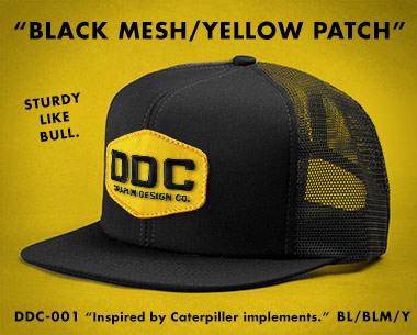 merch_action_black_mesh_yellow_patch.jpg