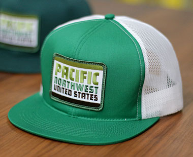 merch_pnw_action_cap_green_white.jpg