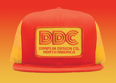 merch_thick_lines_ddc_action_cap_yellow_orange.jpg